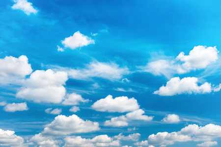 White fluffy clouds on the blue sky. Nature background