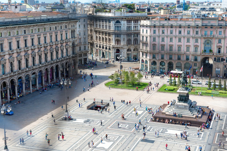aerial view: Aerial view of square from roof of famous Cathedral Duomo di Milano on piazza in Milan, Italy Stock Photo