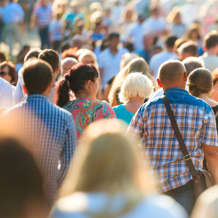 Crowd of people walking on the busy city street. Stock Photo