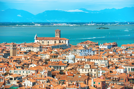 sea of houses: Venice roofs from above. Aerial view of houses, sea and palaces from San Marco tower Stock Photo