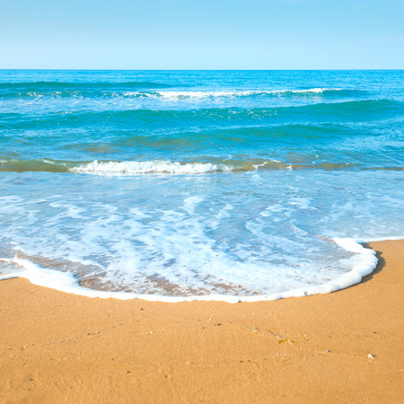 sea beach: Tropical beach with sand and sea wave at background Stock Photo