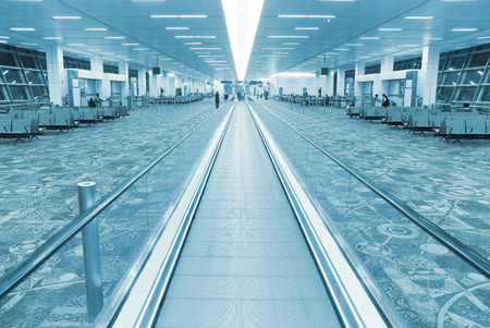 colorized: Interior of airport hall with the flat escalator. Blue colorized image