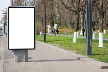 lightbox: Empty billboard or lightbox on green city street with white isolated background