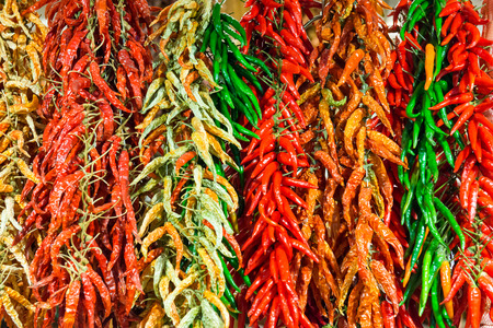 chilly: Bunches of red and green hot chilly peppers on the farmers market