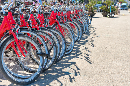 parked bicycles: Group of red city bicycles parking on the street