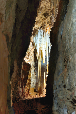 dark cave: Inside of beautiful old dark cave with many stalactites. Grotte di Is Zuddas, Italy, Sardinia Stock Photo