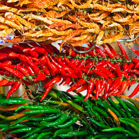 red chilly: Bunches of red and green hot chilly peppers on the farmers market