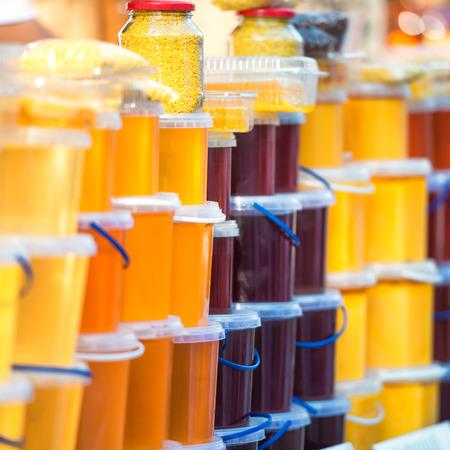 farm market: Many jars with honey on farm market