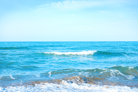 water waves: Waves on the blue sea water at a beach Stock Photo