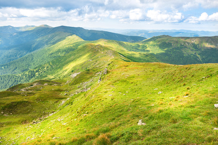 blue green landscape: Landscape with green mountains and hills with blue sky Stock Photo