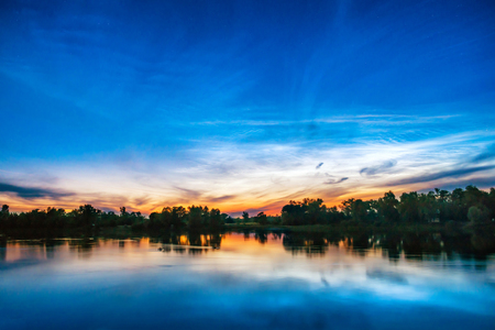 lake sunset: Beautiful colorful sunset on a lake with forest on the other coast, reflection in water