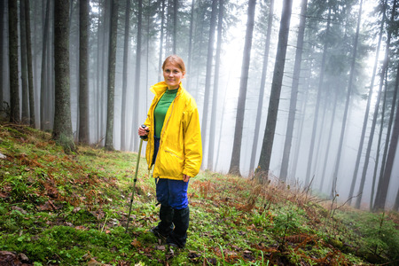 mistery: Pretty woman in mistery forest with mist