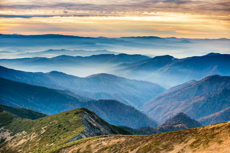 asheville: Blue mountains and hills under beautiful orange sunset