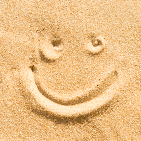 sand drawing: Smile sign drawing on the beach sand
