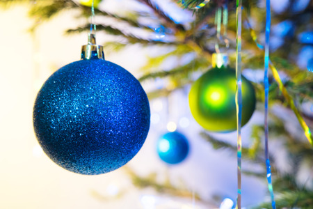 blue and green: Blue and green holiday balls with christmas tree on white yellow background Stock Photo