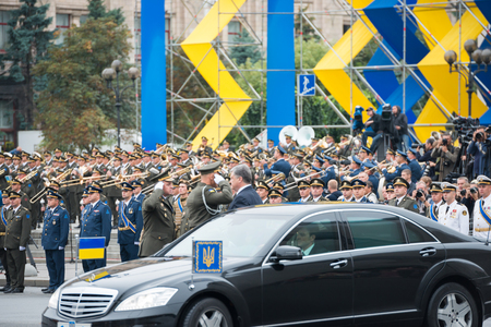 dedicated: KIEV, UKRAINE - AUGUST 24, 2016: Military parade in Kyiv, dedicated to the Independence Day of Ukraine, 25th anniversary. Arriving president Petro Poroshenko to Khreshchatyk street Editorial