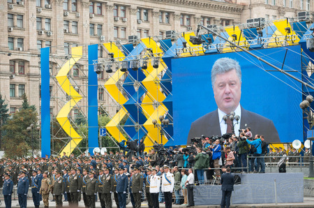 dedicated: KIEV, UKRAINE - AUGUST 24, 2016: Military parade in Kyiv, dedicated to the Independence Day of Ukraine, 25th anniversary. Troops on Khreshchatyk street near screen with president Petro Poroshenko
