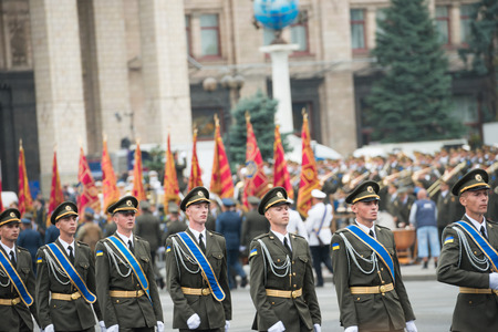 dedicated: KIEV, UKRAINE - AUGUST 24, 2016: Military parade in Kyiv, dedicated to the Independence Day of Ukraine, 25th anniversary. Standard bearers with flags on Khreshchatyk street