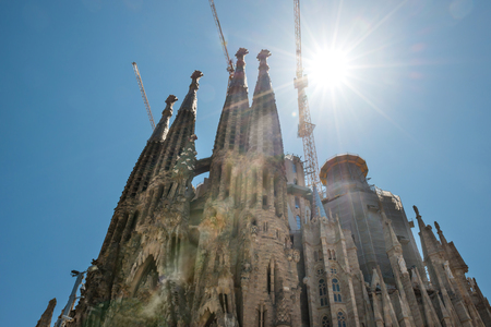 BARCELONA SPAIN - May 21 2016 La Sagrada Familia - View to the facede of cathedral under bright sun, designed by Antonio Gaudi, which is still under construction at May 21, 2016 in Barcelona, Spain. Editorial