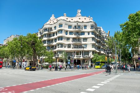 BARCELONA, SPAIN - May 21, 2016: Facade of Casa Mila with crowd of people on the street of Barcelona, Spain. Famous building designed by Antoni Gaudi. Editorial