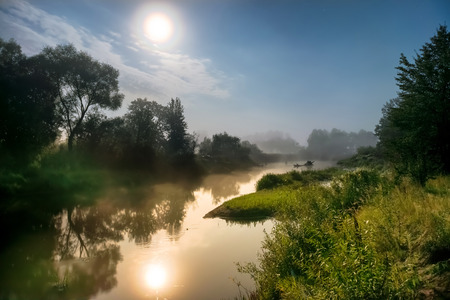 foggy: Landscape with moon light at night over river. Fog above water and trees Stock Photo