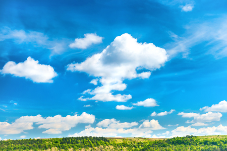 blue green landscape: Landscape with blue sky, white clouds and green trees on hills