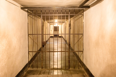 jail: Prison cell with jail iron bars for criminals
