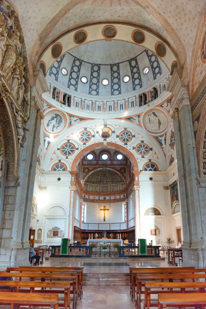 nave: MILAN, ITALY - August 17, 2014: Interior of Milan Duomo Cathedral. Main nave with altar and row of benches