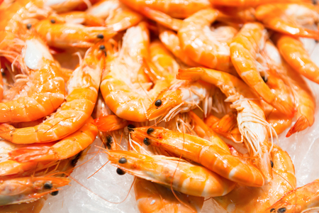 Pile of red fresh shrimps at the market. Seafood texture for background Stock Photo