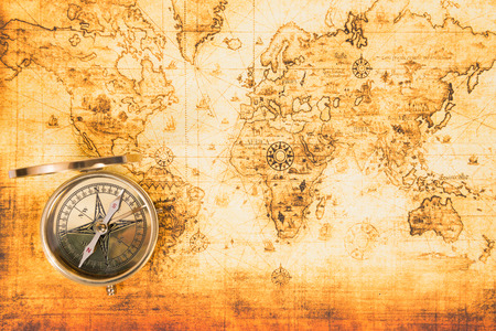 Old paper map with an ancient compass on it. Vintage travel background Stock Photo