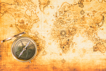 Old paper map with an ancient compass on it. Vintage travel background 版權商用圖片