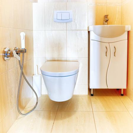 modern bathroom: Toilet bathroom interior with white ceramic seat