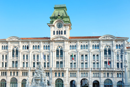 Palace and old buildings on city square in Trieste, Italy Stok Fotoğraf