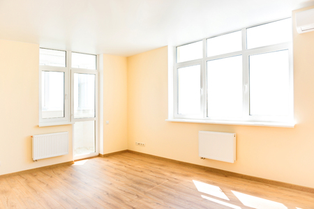 windows frame: Living interior of empty room with wooden floor and light from the big white isolated windows