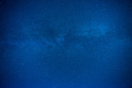 Dark blue night sky with many stars, galaxy background