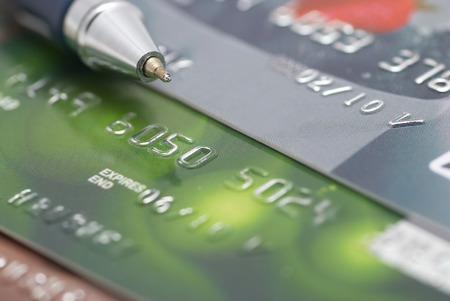 bank robber: Credit cards with pen- concept finance background