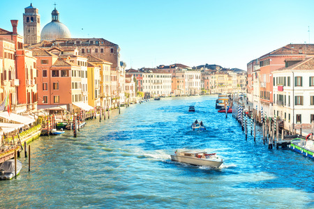 Grand canal in Venice - city travel landscape with boats and gondola