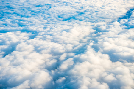 White clouds on blue sky as cloudscape background