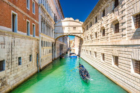 View of Bridge of Sighs over canal with gondolas near Doge's Palace in Venice, Italy