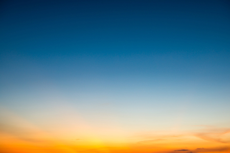 Blue dramatic sunset sky with golden rays of sun light. Can be used as nature background Stockfoto