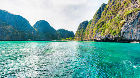 Panorama of famous Phi Phi island in Thailand with sea, boats and mountains in beautiful lagoon where the Beach movie was filmed
