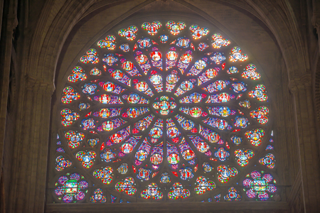 PARIS, FRANCE - SEPTEMBER 26, 2018 North Rose vitrages stained glass window in interior of cathedral Notre-Dame de Paris before fire April 15, 2019. Paris, France Editorial