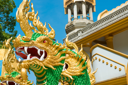 Statues of green dragons at entrance to buddhistic pagoda Tham Sua near Tiger Cave Temple in Krabi, Thailand