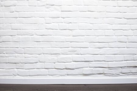 White brick wall with wooden floor can be used for background Banque d'images