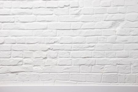White brick wall with plinth can be used for background