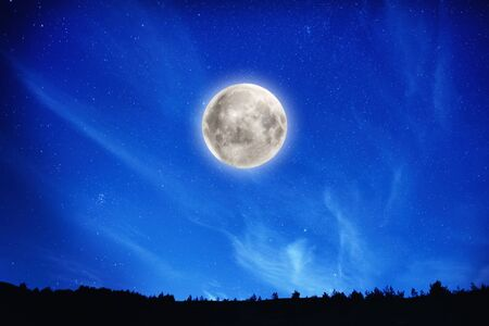 Big full moon on night sky with stars and forest on background Stok Fotoğraf