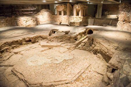 MILAN, ITALY - SEPTEMBER 29, 2018: Archaeological museum Duomo di Milano. Remains of Basilica di Santa Tecla and ruins of baptistery. Milan, Italy