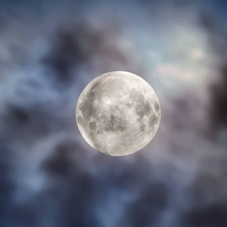 Big full moon on night sky with clouds and space background