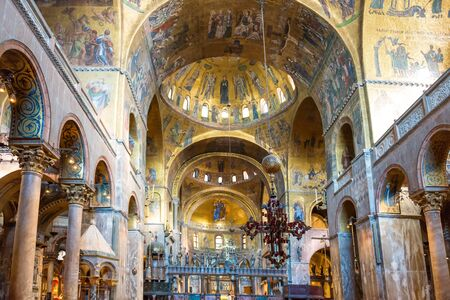 Luxury interior of Saint Marks Basilica with gold and lots of mosaics. Venice, Italy