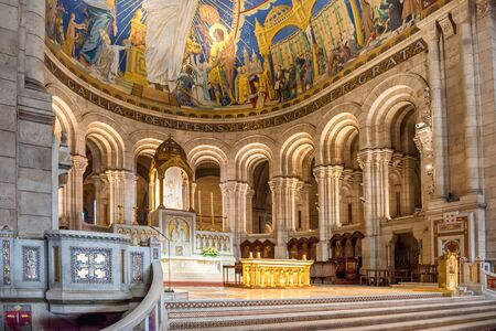 PARIS, France - SEPTEMBER 24, 2018 : Inside of basilica Sacred Heart Coeur Sacreon on Montmartre in Paris - interior with mosaic on walls Редакционное